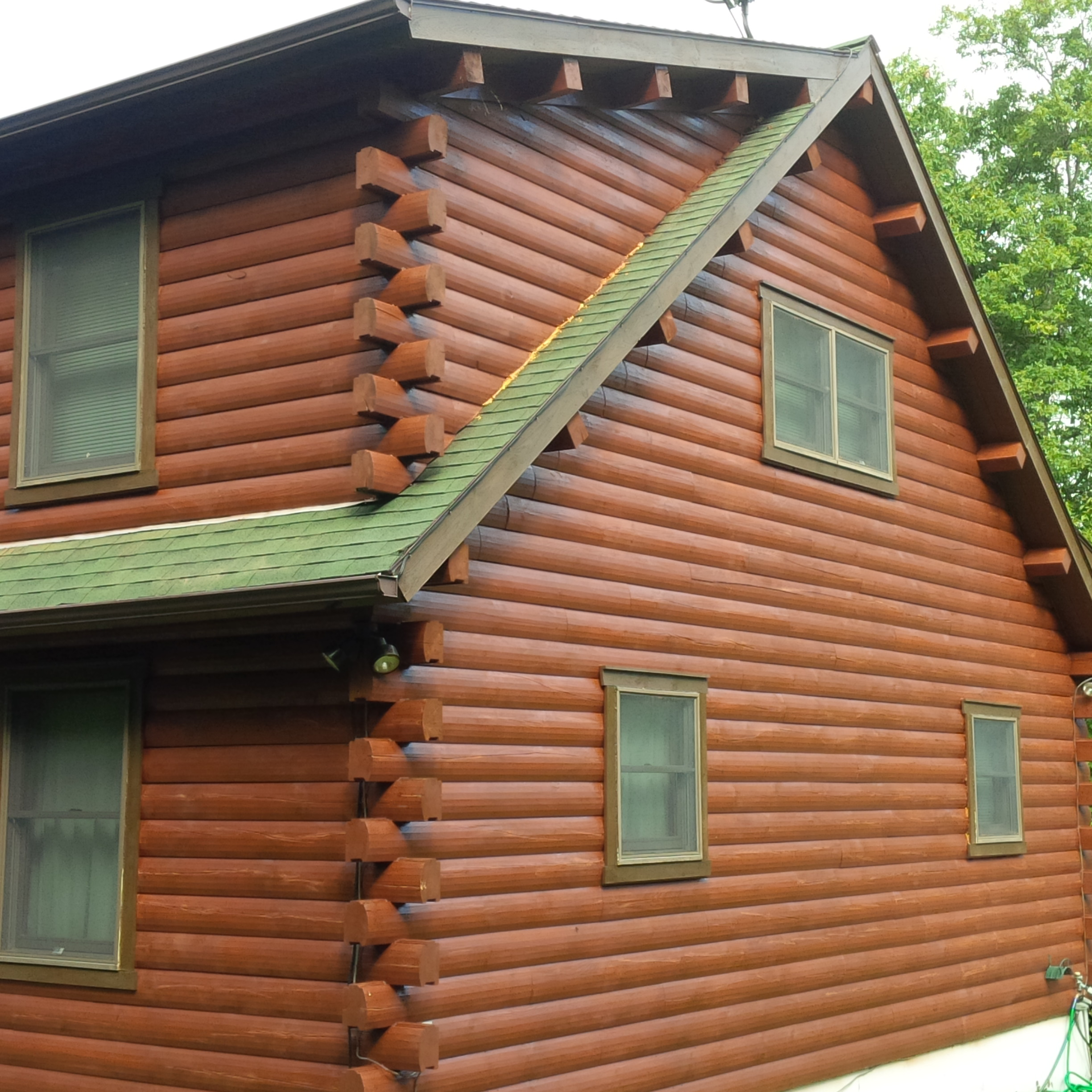 Painting log cabin exterior colors joy studio design for How to stain log cabin